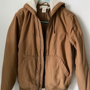 Brown coat with white fur lining